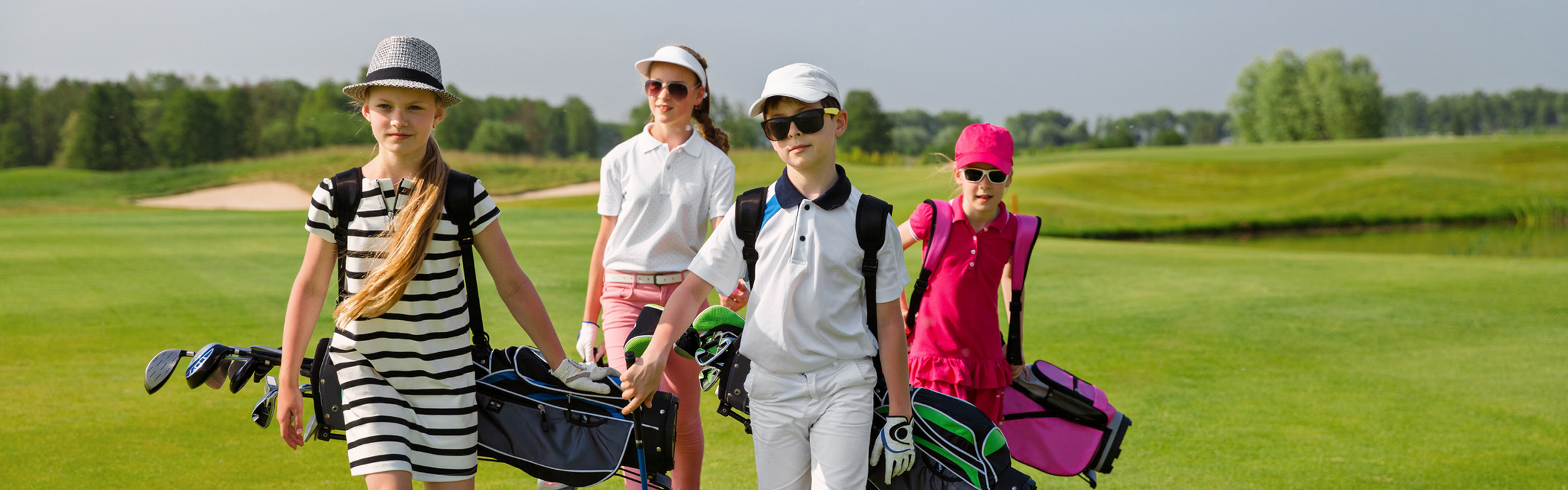 kids from golf camp walking down the fairway